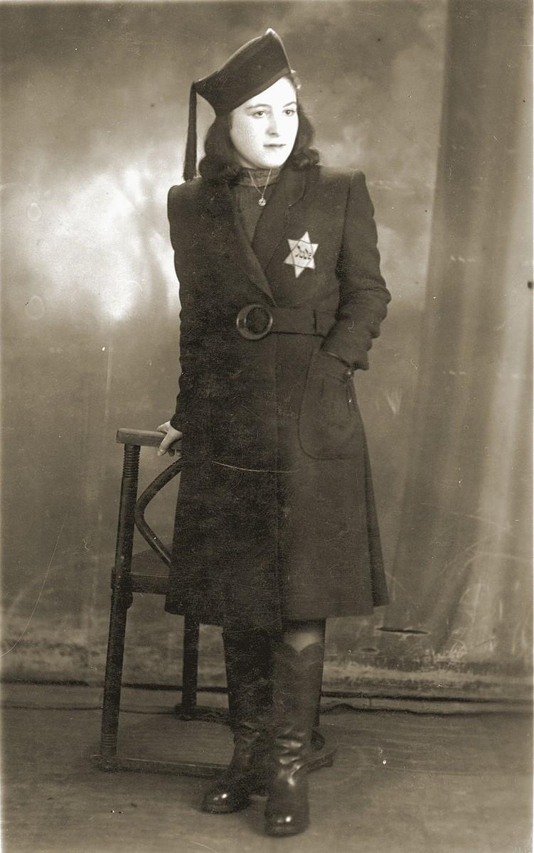 Studio portrait, taken in th Bedzin ghetto, of Mania Cawadel wearing a Jewish star.