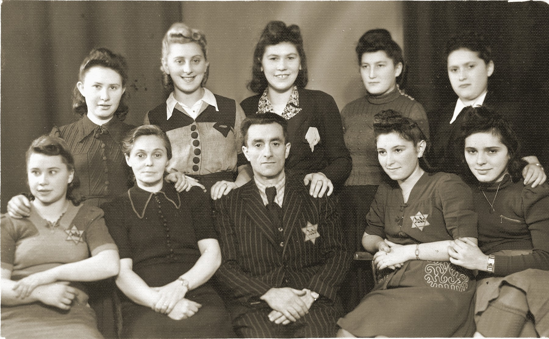 Members of the Rotmensch group of the Rossner factory in the Bedzin ghetto.  Among those pictured are Mania Cawadel and Romensch (botton row, center)