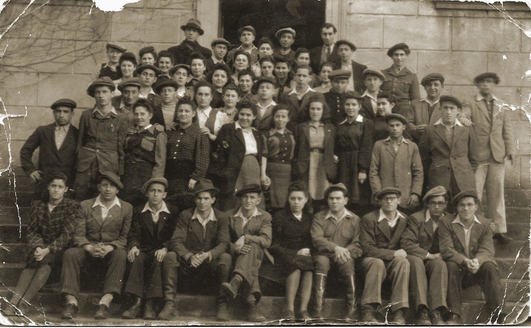 Members of Kibbutz Magshimim in Bedzin Poland.  Izhak Lauer is seated first row, fifth from the left.  Esther Urman is standing fourth row, third from the left.