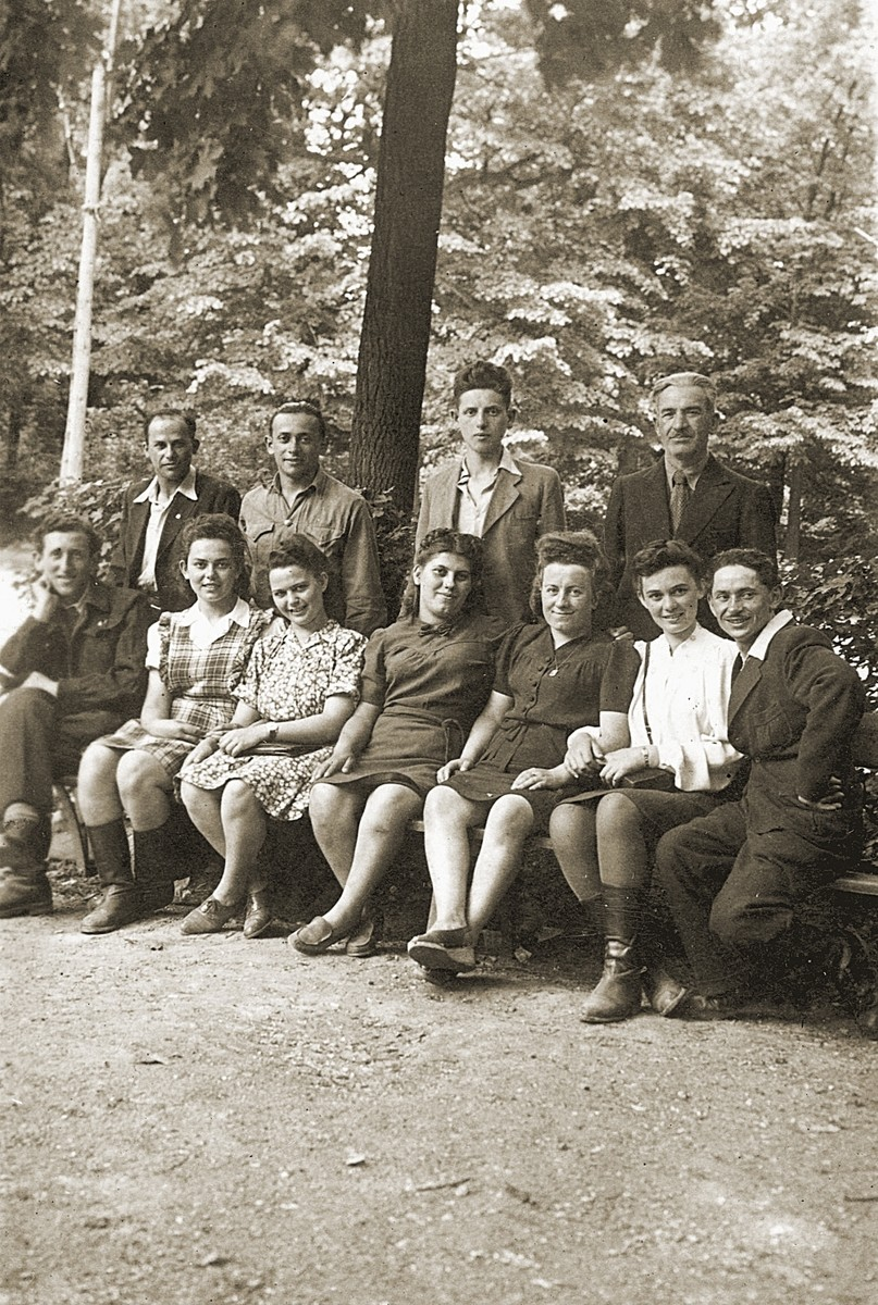 Members of Kibbutz Magshimim pose on a park bench on route to Italy where they will catch a boat to Palestine.