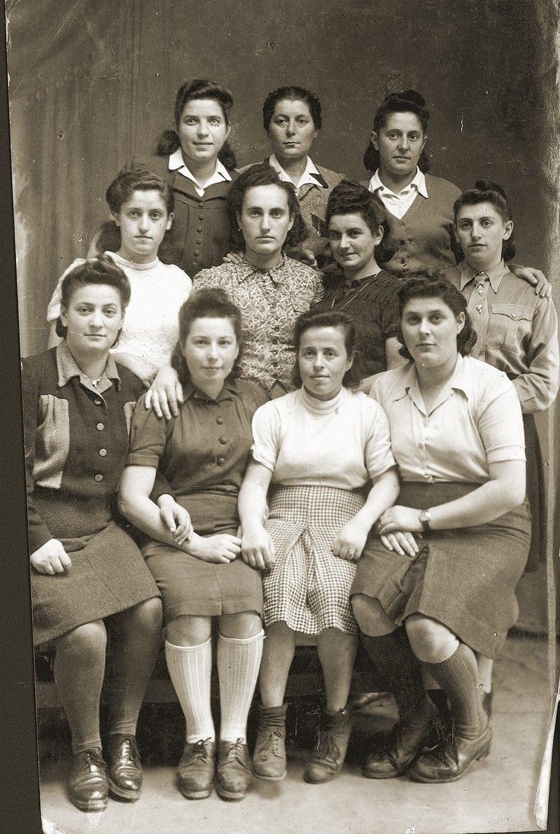 Members of Kibbutz Magshimim in Bedzin, Poland.  Esther Urman is in the middle row, second from the right.