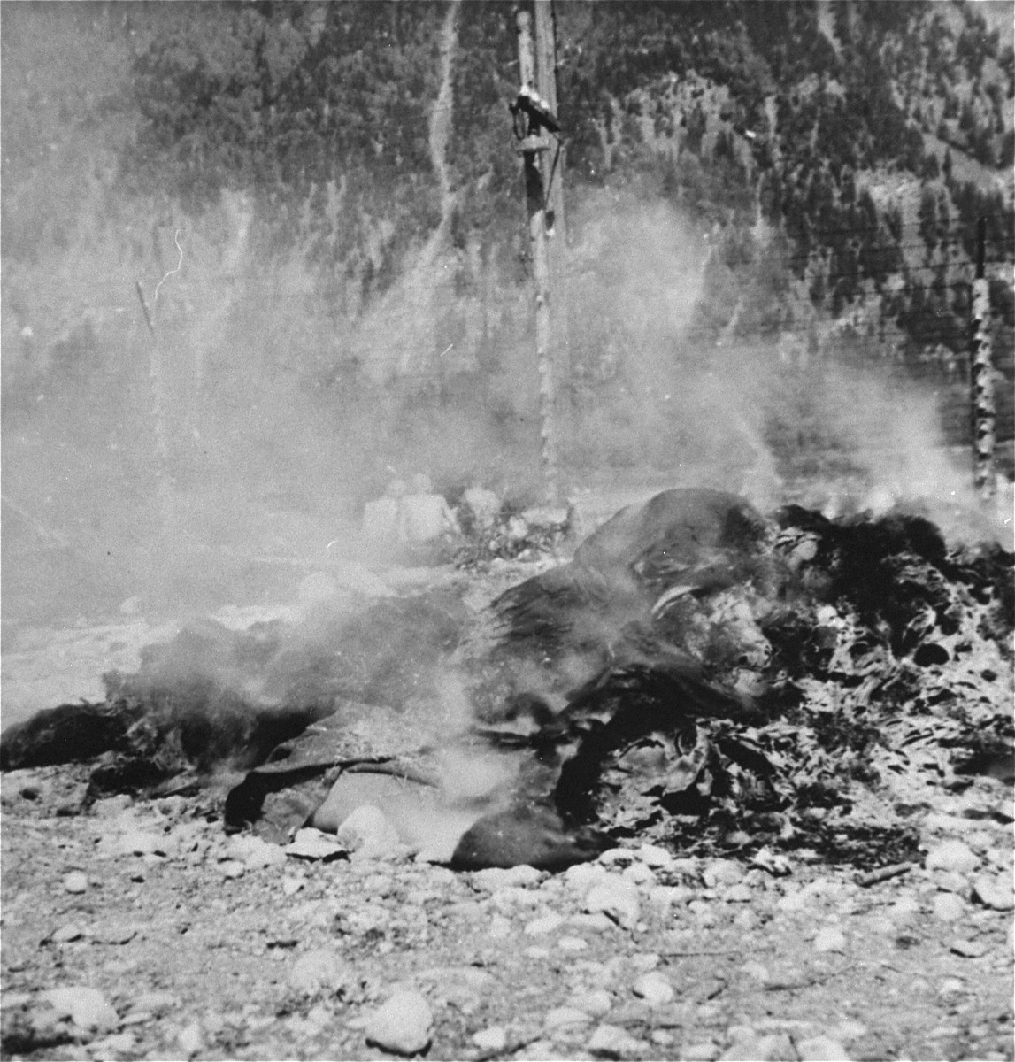 A pile of burning clothing in Ebensee.    The rags of survivors were burned to control an outbreak of infectious disease.