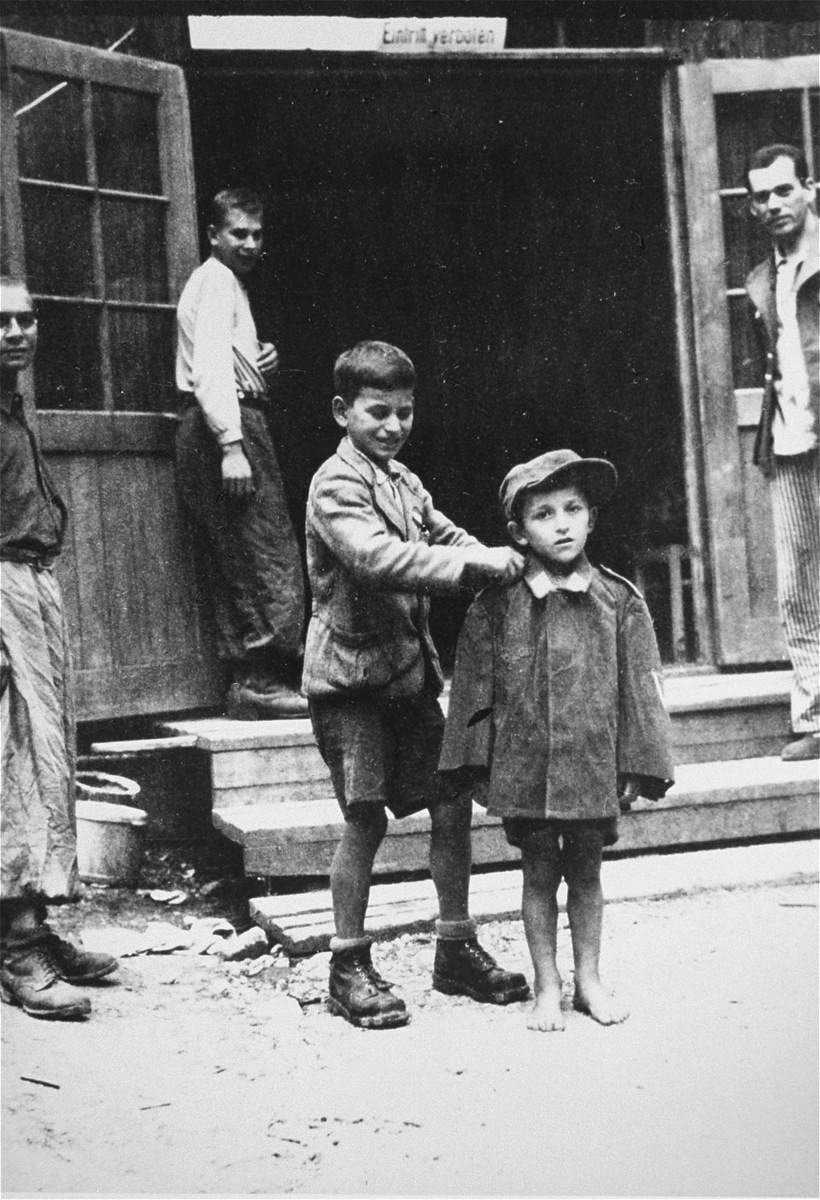 Children survivors stand in front of a barracks in the newly liberated Ebensee concentration camp.