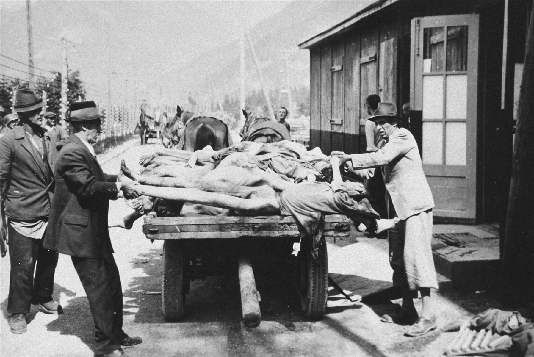 Austrian civilians remove bodies from Ebensee to a nearby site for burial.