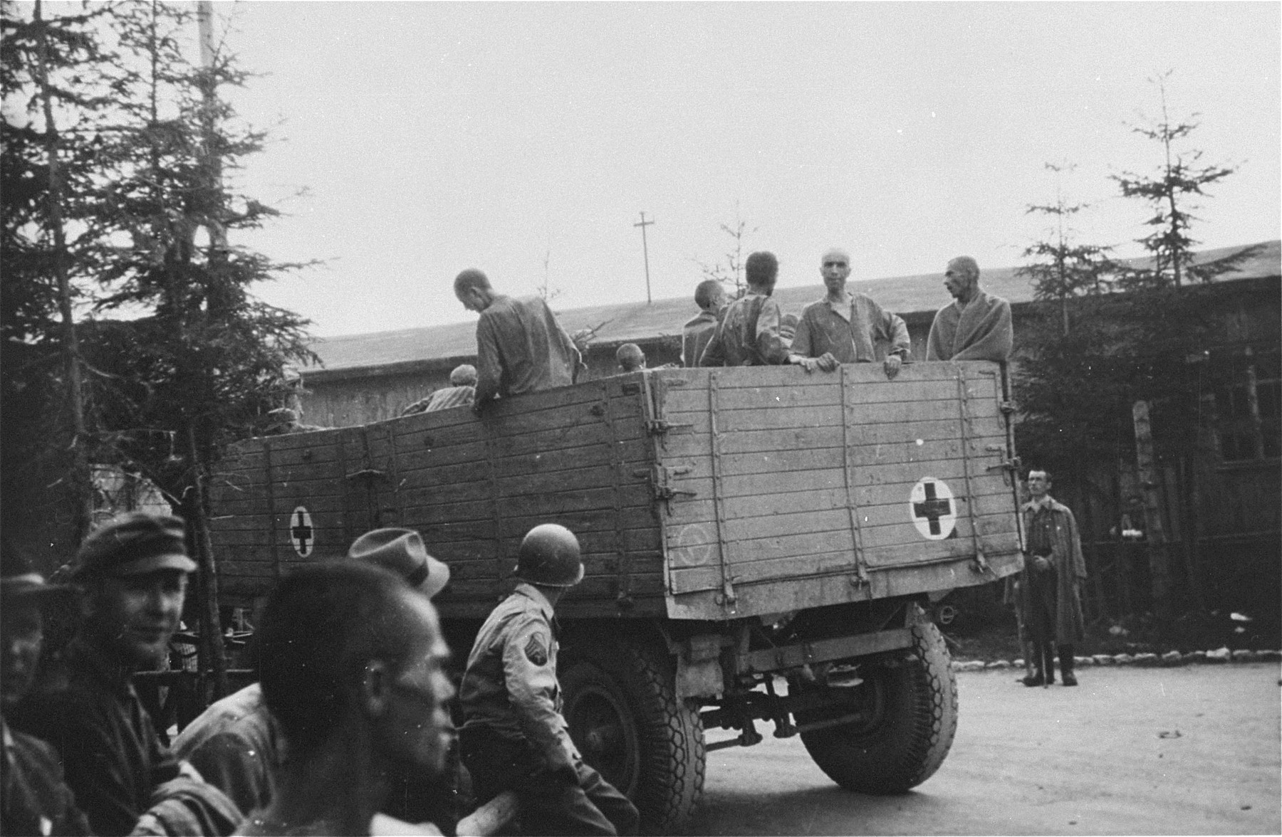Evacuating survivors from Ebensee to the 139th Evacuation Hospital for medical care.