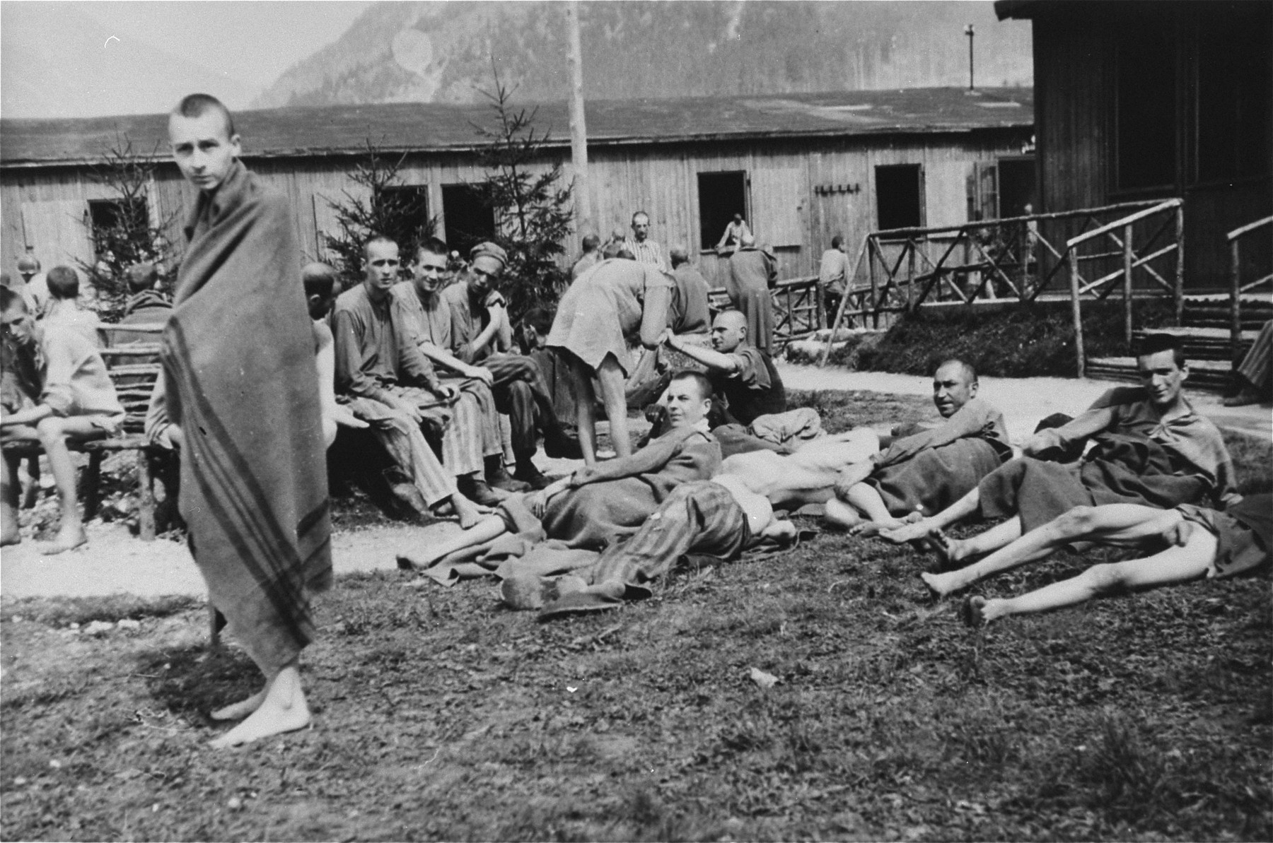 Survivors gather in Ebensee.    The man in the foreground is Mr. Fajwel, originally from Kalisz, Poland, imprisoned in Warsaw ghetto, Czestochowa ghetto - Hassag labor camp, Bedzin ghetto, Auschwitz-Birkenau, Swietochowice and Ebensee, where he was liberated by the U.S. Army.