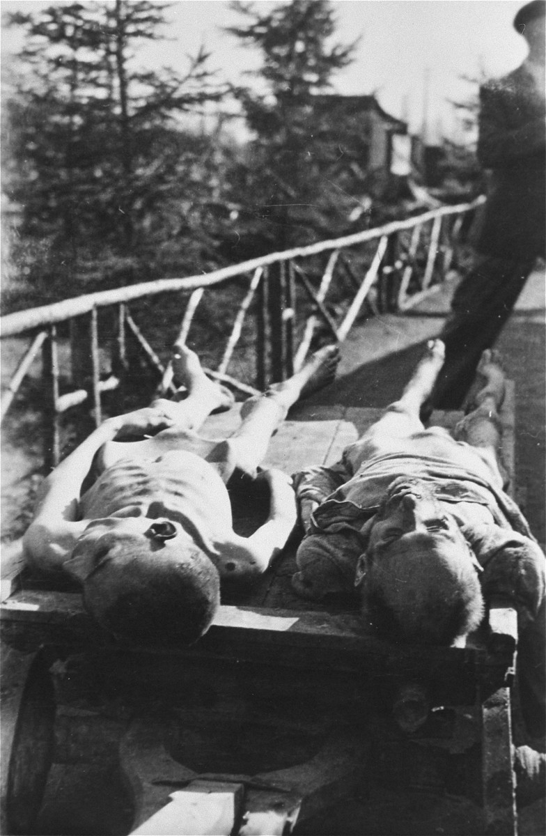 Corpses lie on a cart in Ebensee.