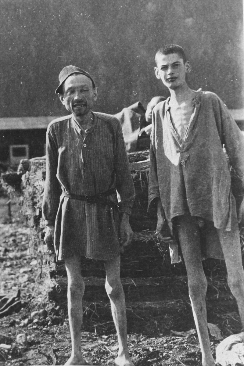 Two emaciated survivors from the infirmary for Jews in Ebensee, a sub-camp of Mauthausen which was liberated by a unit of the 3rd Cavalry Recon. Sqd., U.S. Third Army, on 6 May 1945.