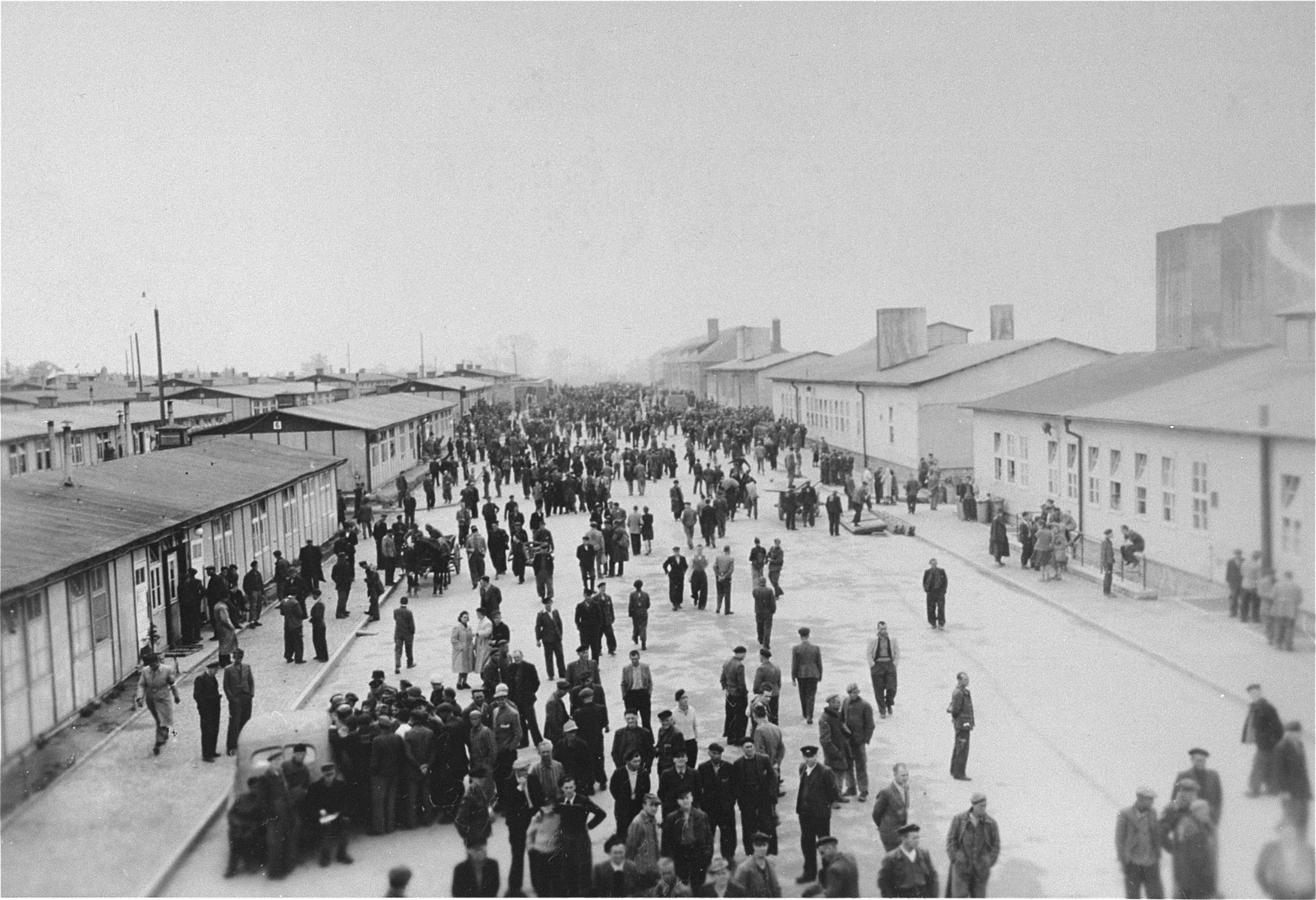 Survivors walk along the main street of the Mauthausen concentration camp.