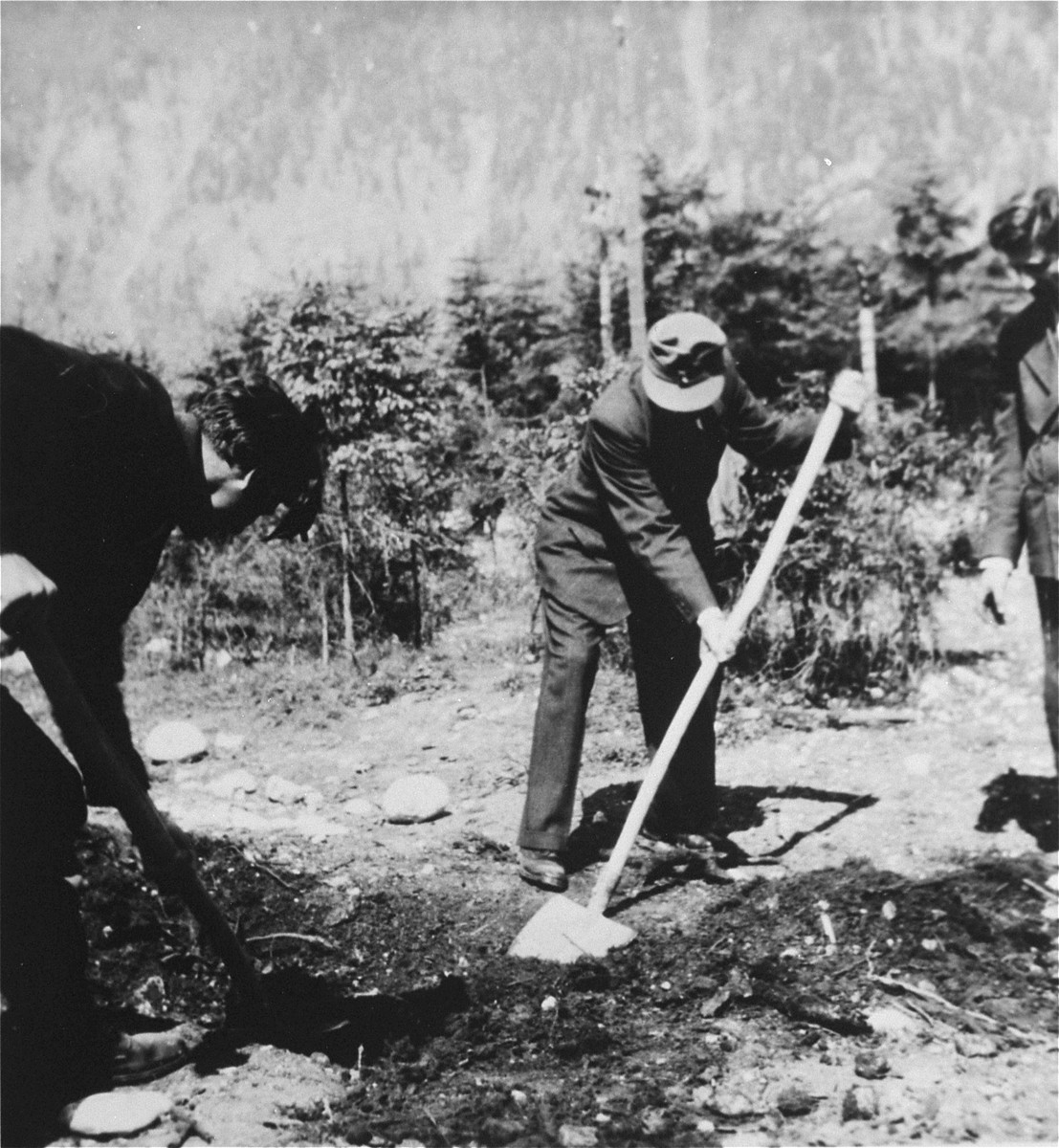 Austrian civilians exhume a mass grave in the Ebensee concentration camp.