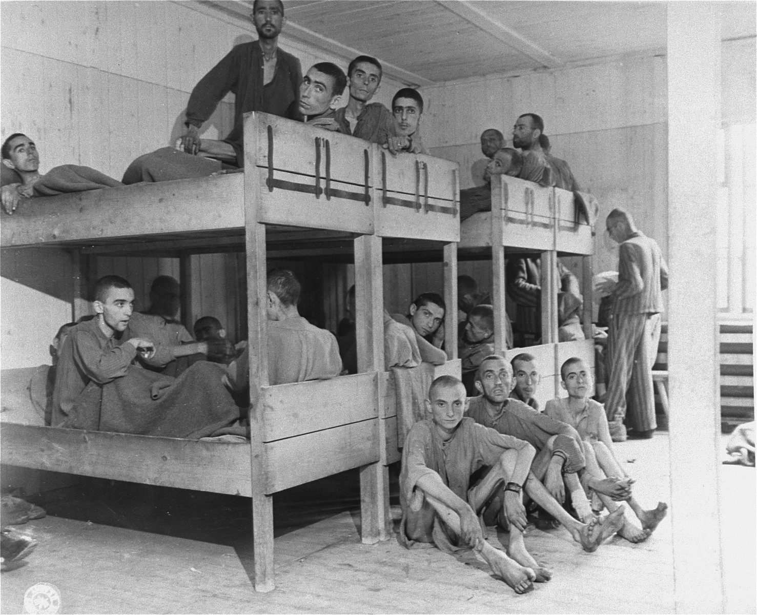 Survivors lie on bunks in the infirmary barracks for Jewish prisoners in the Ebensee concentration camp.