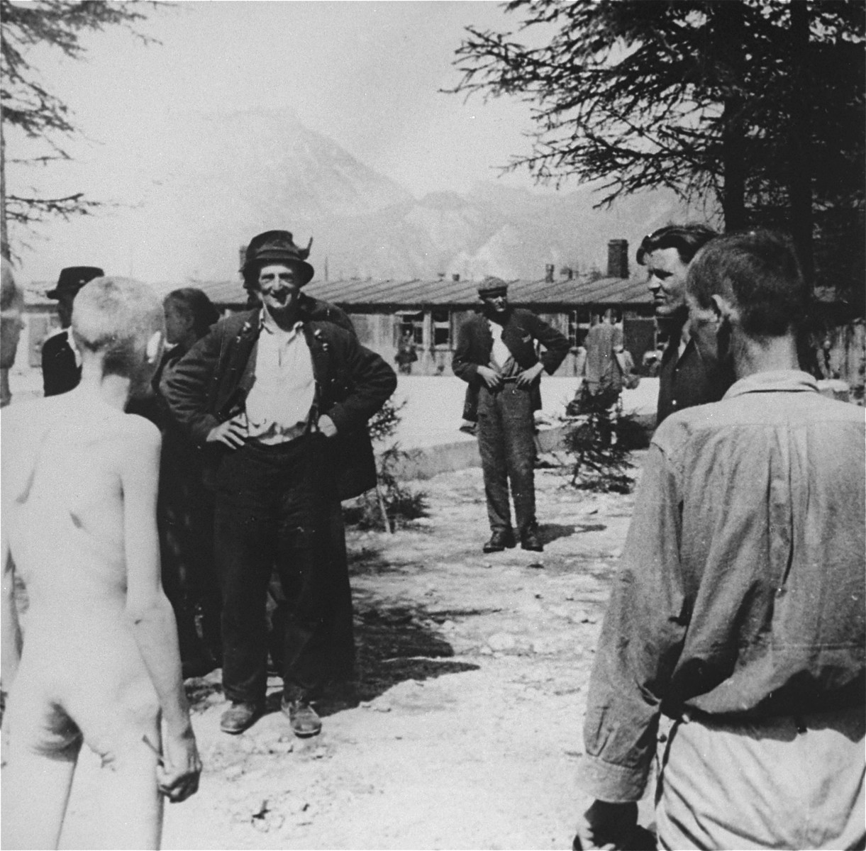 Austrian civilians visit the newly liberated Ebensee concentration camp.
