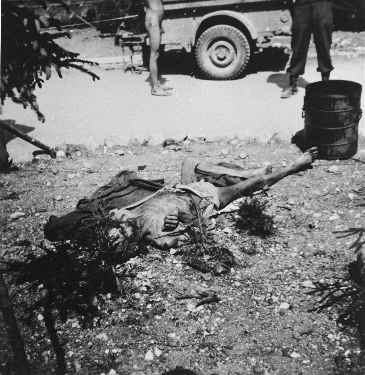 A corpse lies on the ground in the Ebensee sub-camp of Mauthausen after liberation.