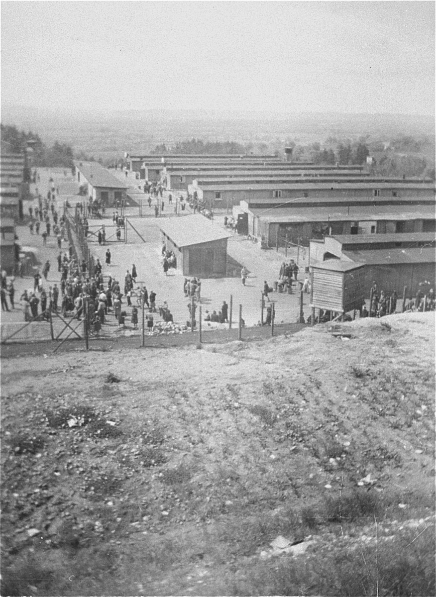"""View of the """"Russian camp"""" at Mauthausen soon after the liberation.    The fenced off area in the foreground is the """"sick camp""""."""