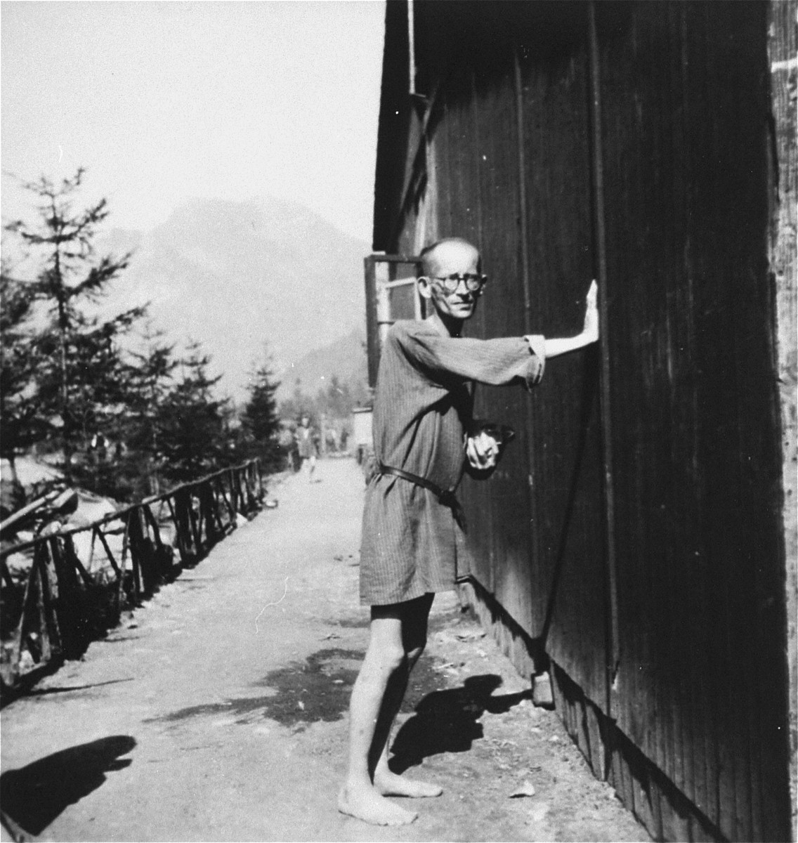 A survivor stands outside the hospital compound in Ebensee.