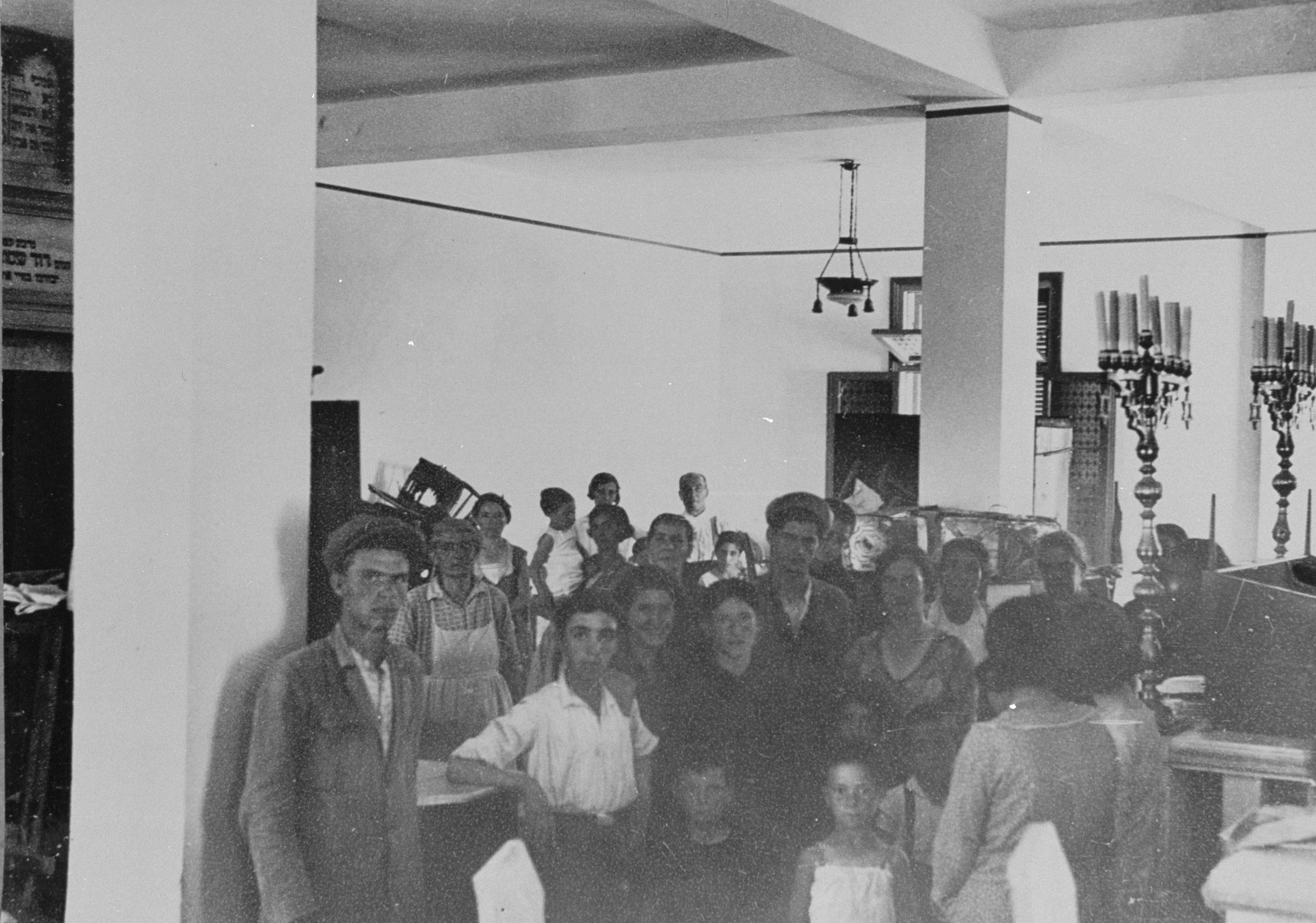 Jewish families take refuge in a  synagogue in Salonika after the pogrom at Camp Campbell.