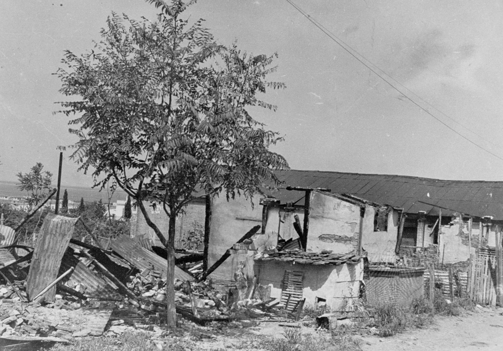 Remnants of a wooden barracks in the Campbell camp after the pogrom of June 29th.