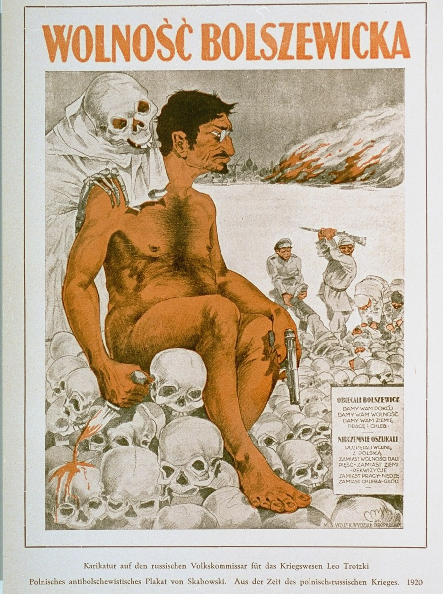 """Antisemitic and anti-Bolshevik poster depicting a naked Leon Trotsky sitting on a pile of skulls.    The title reads: """"Bolshevik Freedom.""""  The caption on the right reads: """"Bolsheviks promised: We will give you peace; we will give you freedom; we will give you land, jobs, and bread.  They deceived us: they initiated war with Poland.  Instead of freedom, they gave us a fist; instead of land -- expropriation; instead of  jobs -- destitution; instead of bread -- famine.""""  The poster was designed by Skabowski and printed by the Polish Army poster division.   An antisemitic caricature published in Eduard Fuchs, """"Die Juden in der Karikatur: ein Beitrag zur Kulturgeschichte."""" Albert Langen, 1921."""