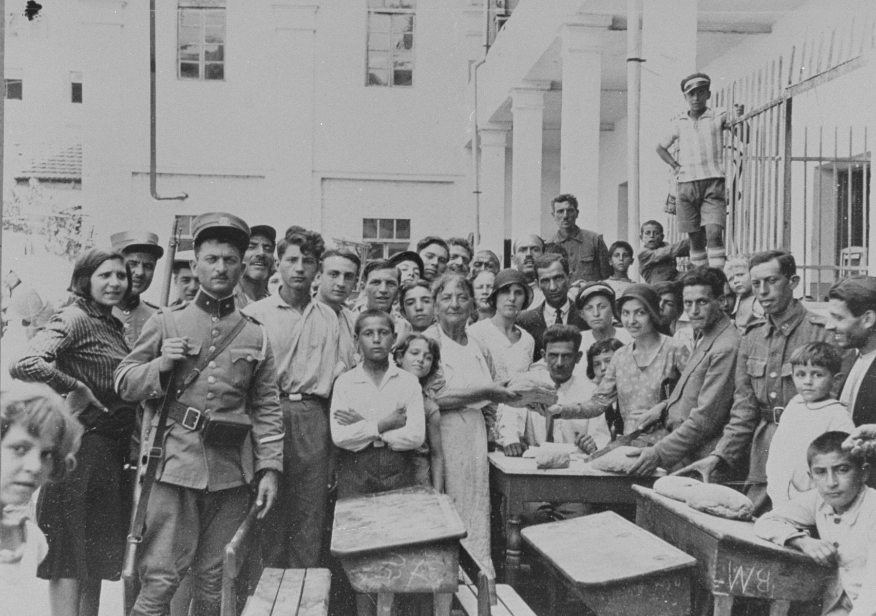 Jews take refuge in one of the local schools after a pogrom destroyed their community.