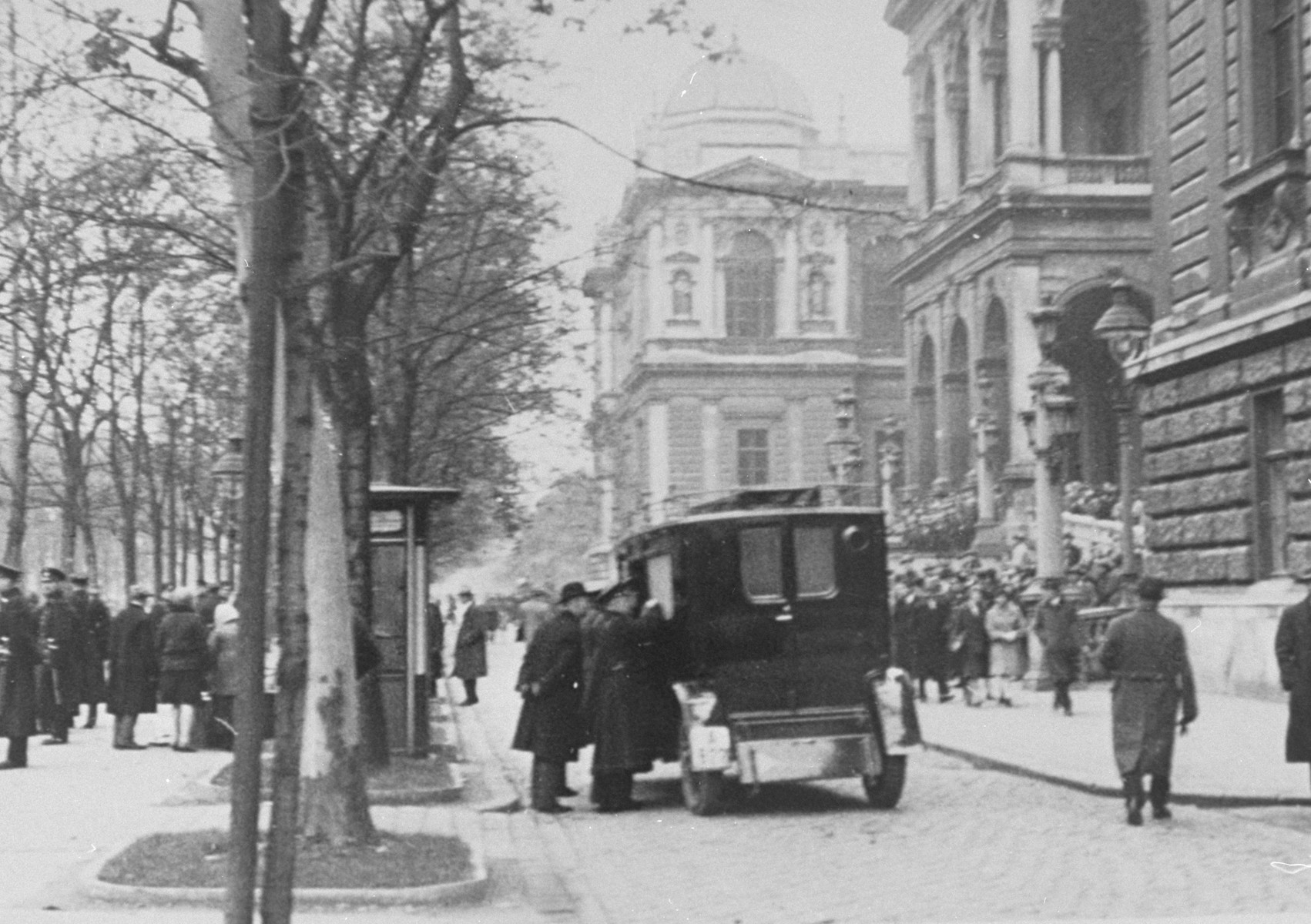 An ambulance takes students wounded during riots at the University of Vienna to the hospital. The riots occurred after Nazi attempts to prevent Jews from entering the University.
