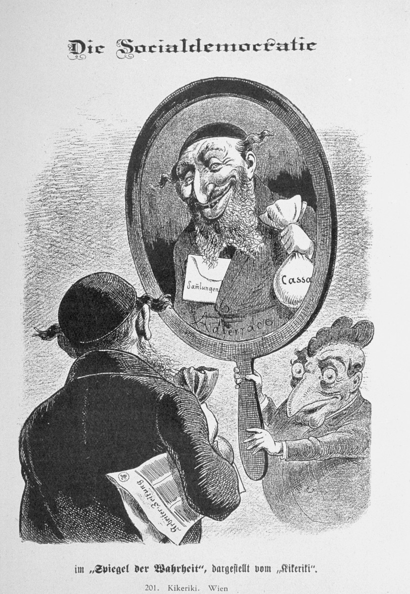 "Caricature from the antisemitic Viennese magazine Kikeriki.  The text reads: ""Social Democracy in the 'mirror of the truth' as portrayed by Kirkeriki.""  In the mirror is a Jew holding a  money bag.  Inside his jacket is an envelope marked ""collections"" and on the mirror is written ""the noble race.""   An antisemitic caricature published in Eduard Fuchs, ""Die Juden in der Karikatur: ein Beitrag zur Kulturgeschichte."" Albert Langen, 1921."