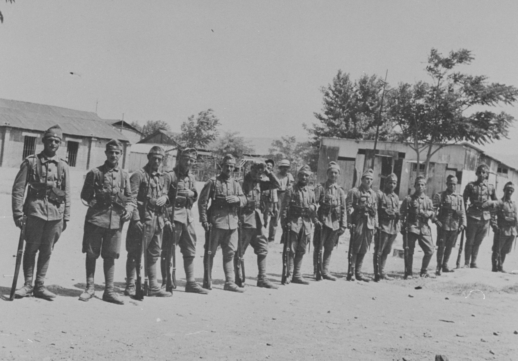 Greek soldiers guard the barracks that were left intact after the pogrom of June 29, 1931.
