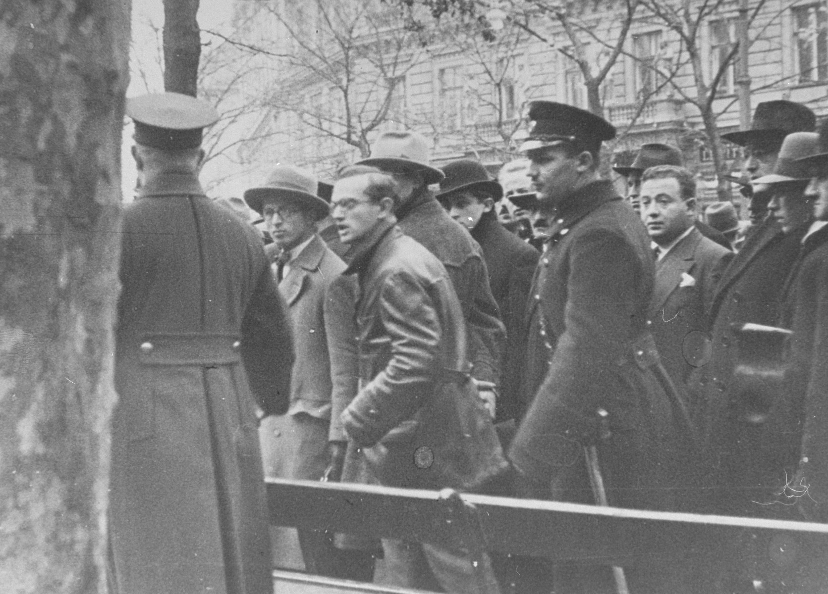 Police attempt to suppress the riots that broke out at the University of Vienna when Nazis sought to prevent Jewish students from entering the building.