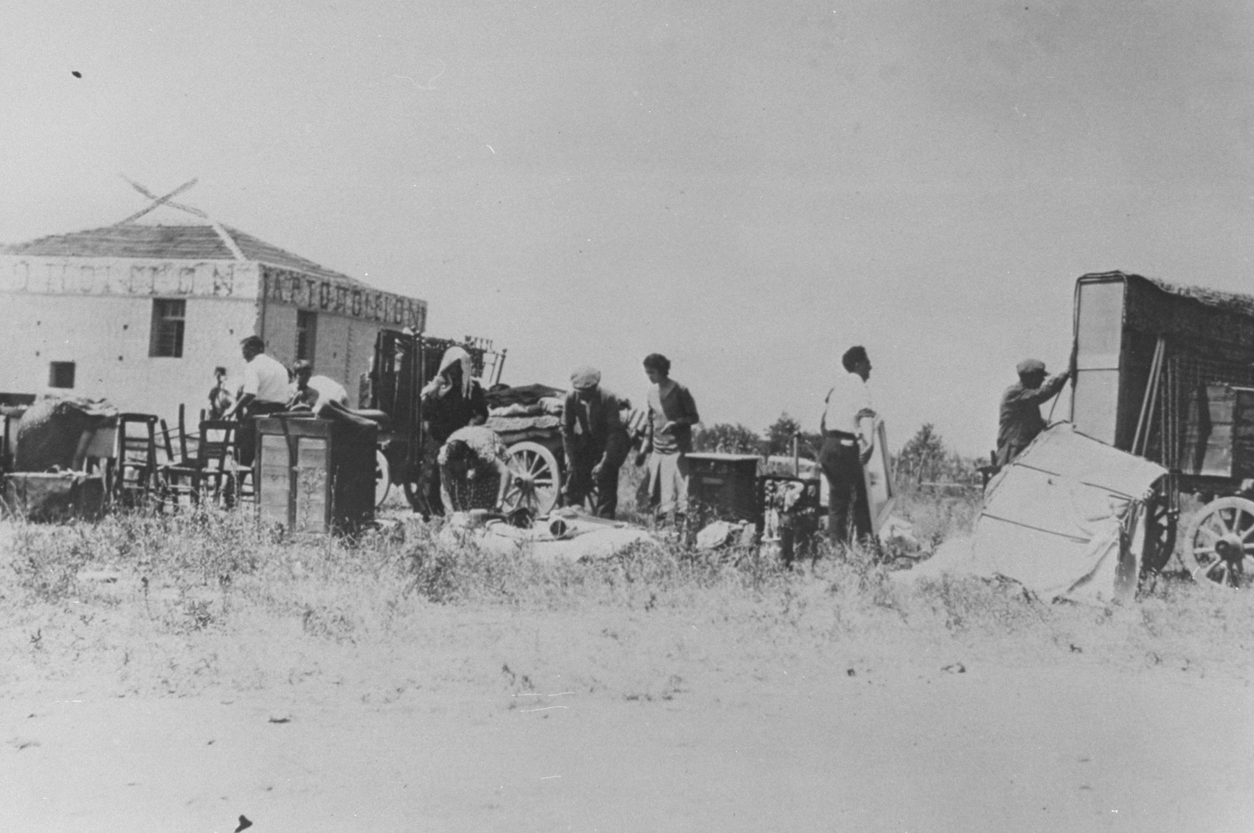 Jews evacuate Camp Campbell after the pogrom of June 29, 1931.