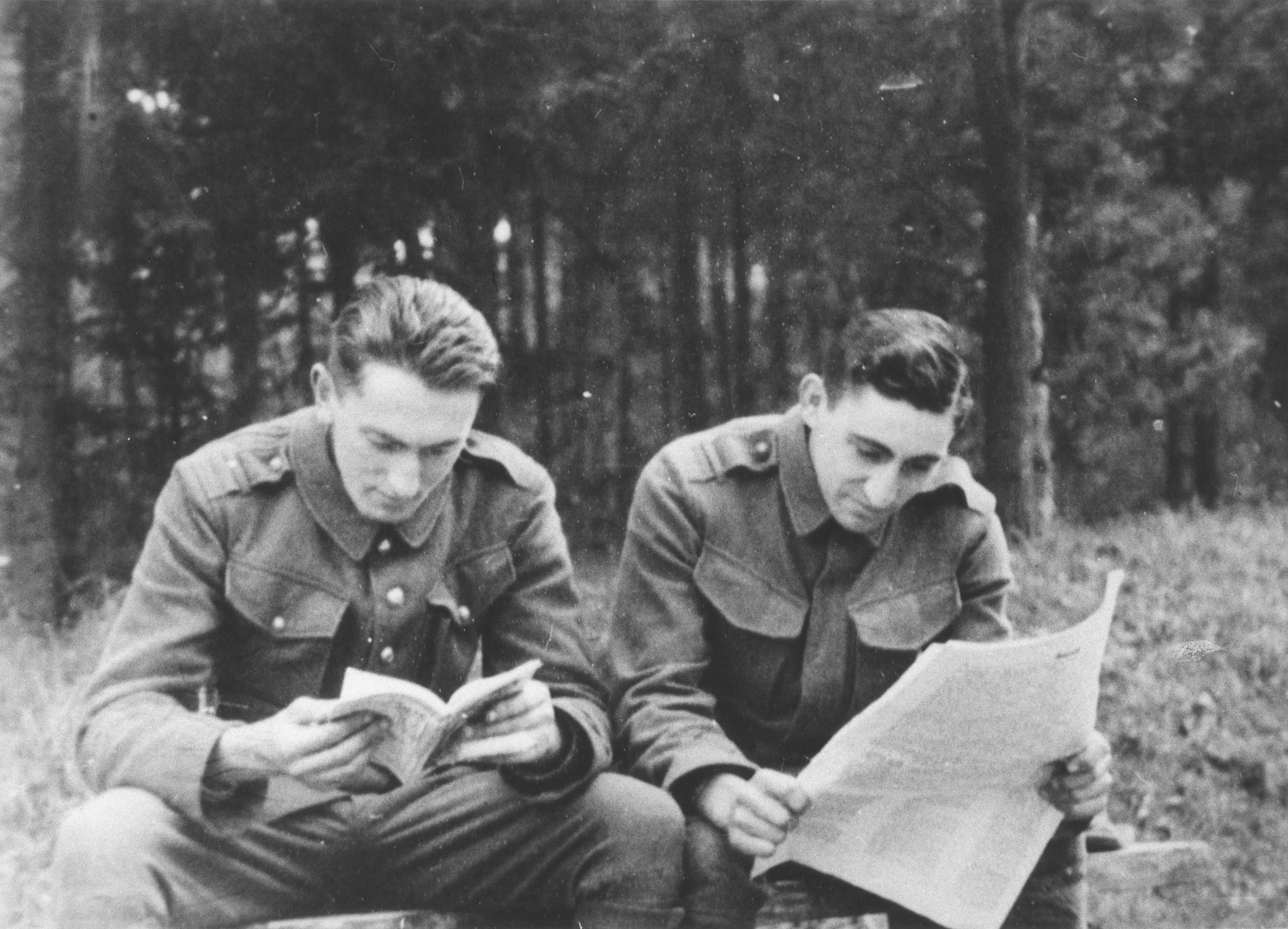 Two Jewish members of the Sixth Labor Battalion (VI Prapor) read outside at a Slovak labor camp.