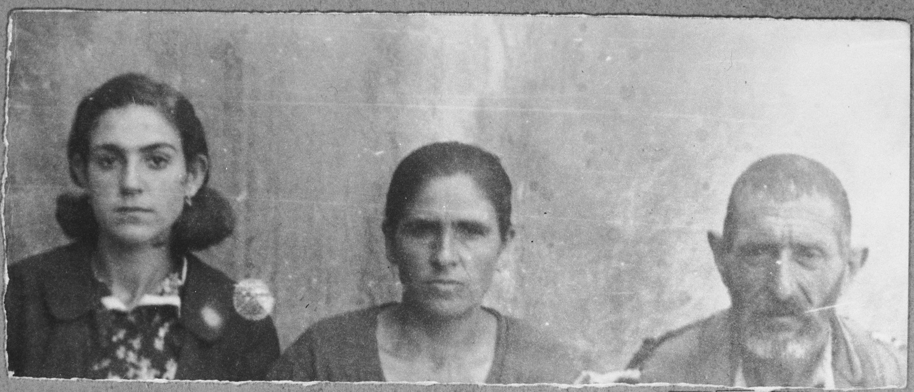Portrait of Bohor Koen, his wife, Vida and his daughter, Mato.  Bohor was a porter.  Mato was a housemaid.  They lived at Drinska 119 in Bitola.