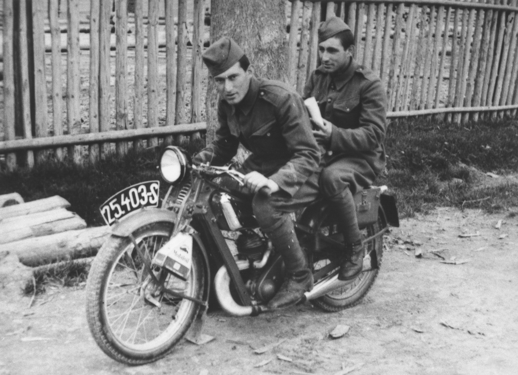 Two Jewish members of the Sixth Labor Battalion (VI Prapor) ride a motorcycle at a Slovak labor camp.