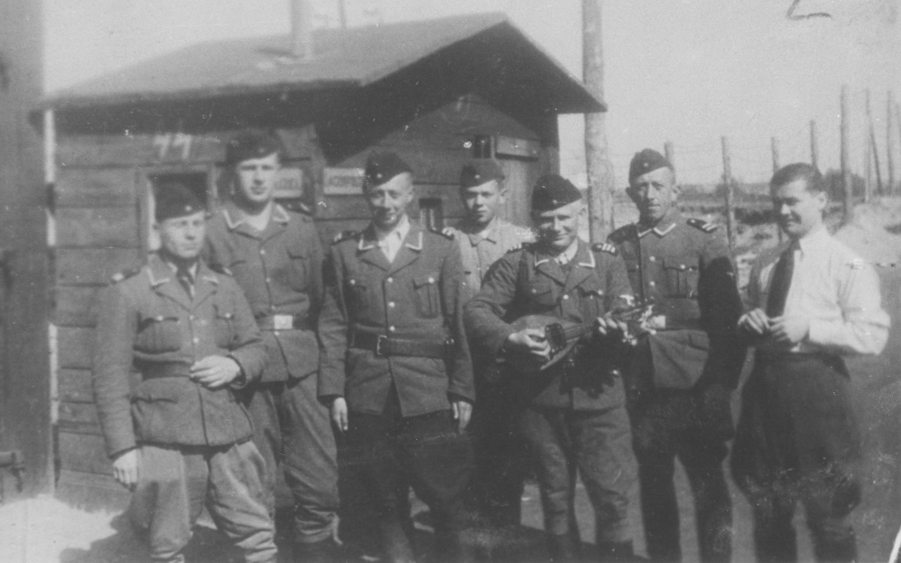 Group portrait of ethnic German guards at the Belzec concentration camp, one of whom plays a mandolin.    Pictured from left to right are: Trautwein, Samuel, Rosenholz and Kunz.  These ethnic Germans served as officers in the Trawniki guard unit in the Belzec concentration camp.