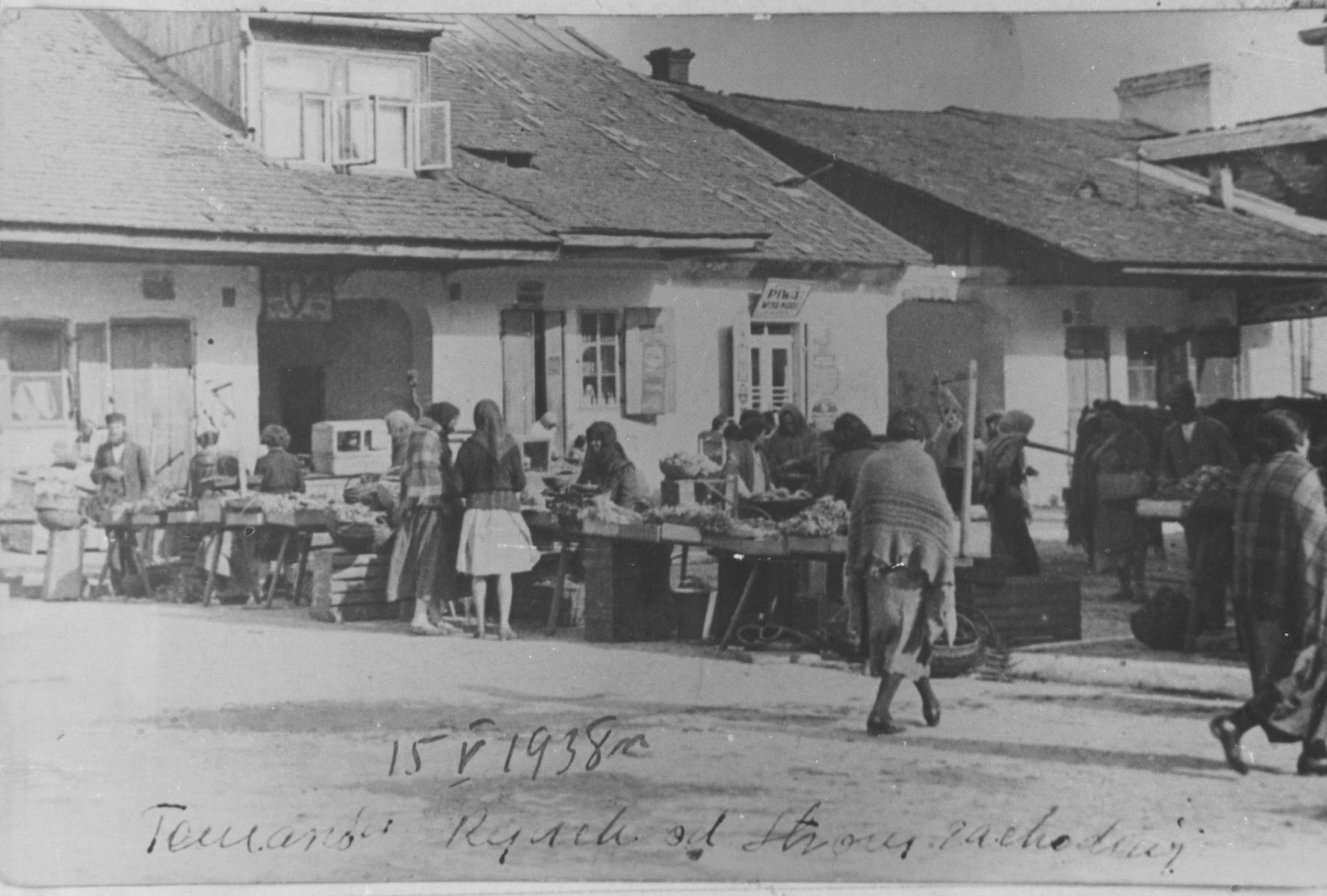 Local residents shop at the outdoor market in Tomaszow Lubelski.