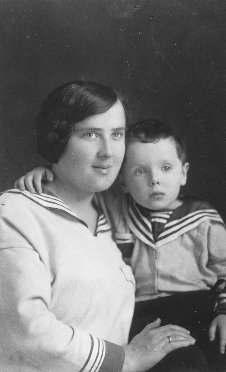 Studio portrait of Sara Limon Tec holding her son, Leon.  Leon attended medical school in Vilna and then immigrated to Palestine in 1940.