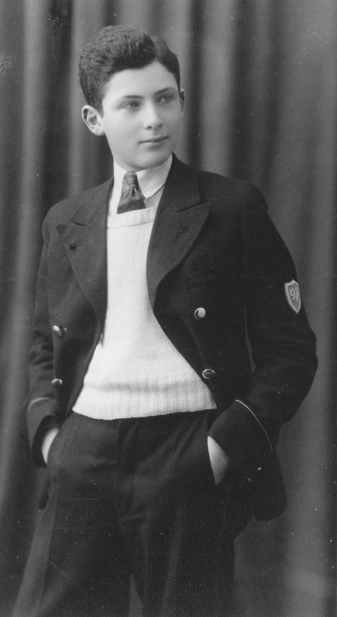 Studio portrait of Leon Tec wearing his high school uniform.  Leon attended medical school in Vilna and then immigrated to Palestine in 1940.