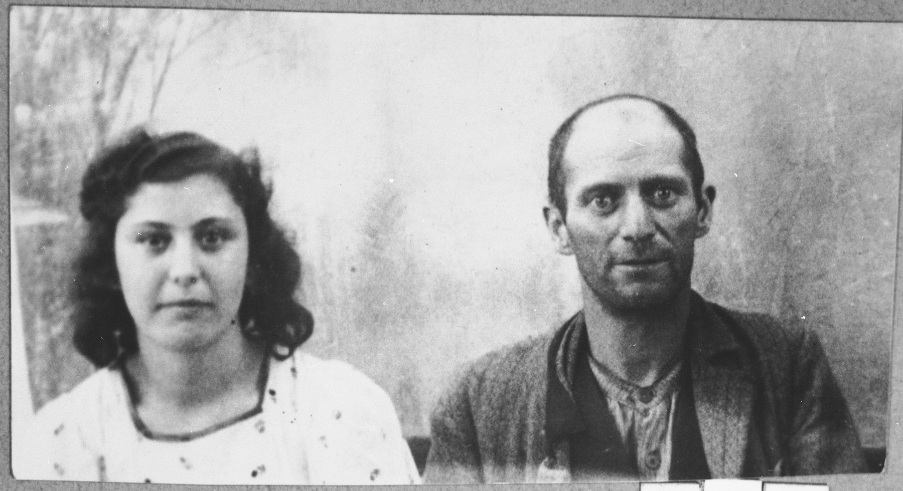 Portrait of Nissim Koen, son of Shalom Koen, and his daughter, Bela Koen.  Nissim was a Miller.  Bela was a student.  They lived at Banatska 21 in Bitola.