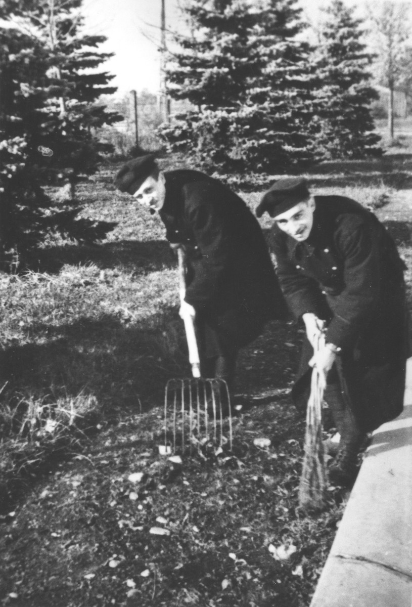 Two Jewish members of the Sixth Labor Battalion (VI Prapor) dig out the foundation of a barracks at a Slovak labor camp.   Pictured are Paul Spitzer (left) and Ervin Kohn (right).