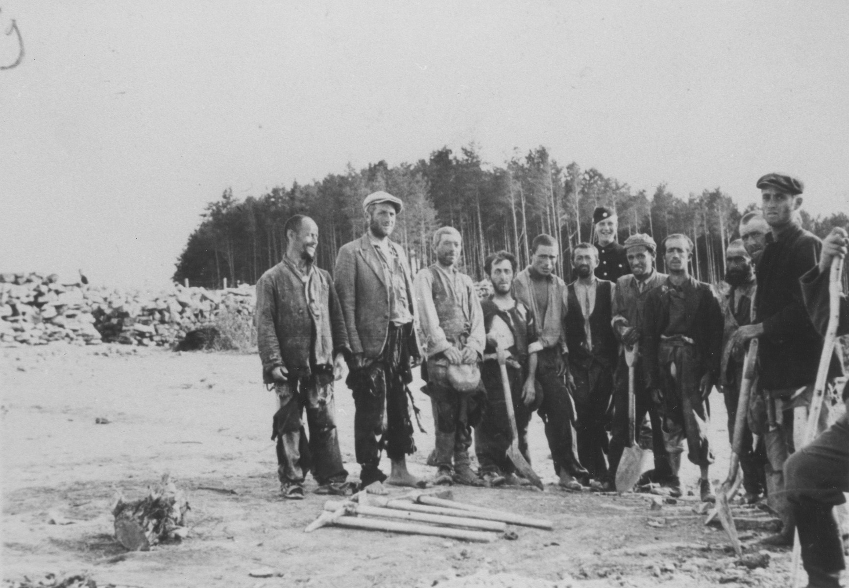 Group portrait of Jewish forced laborers at the Belzec camp.