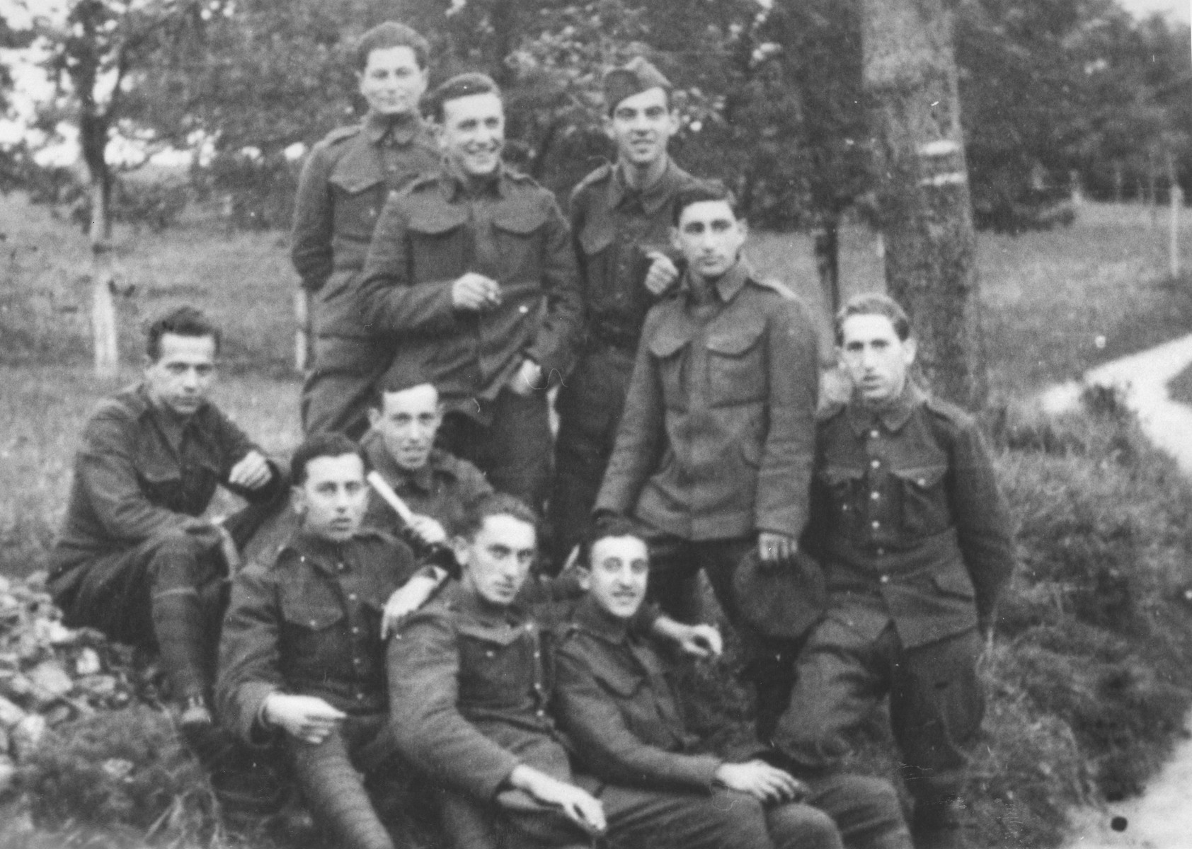 Group portrait of Jewish members of the Sixth Labor Battalion (VI Prapor) at a Slovak labor camp.   Among those pictured is ? Brigler (standing, wearing hat), from Michlovc, Slovakia.