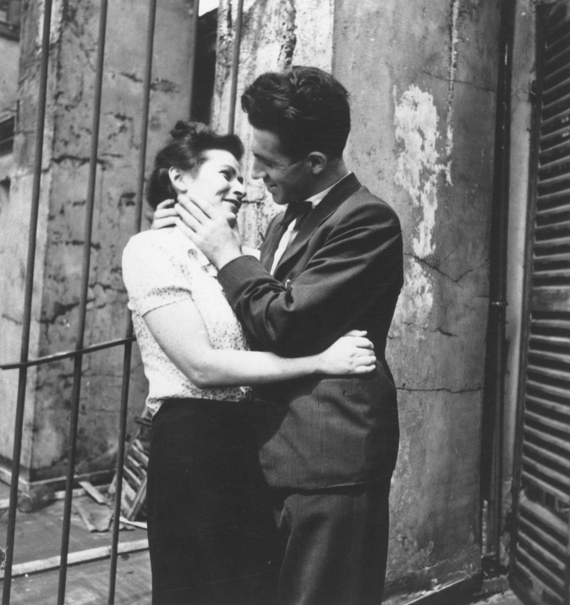 """Bill Freier (Willi Spira) embraces his fiancee, Mina.  The caption on the verso of the photograph reads, """"Bill Spira with his beloved Mina."""""""