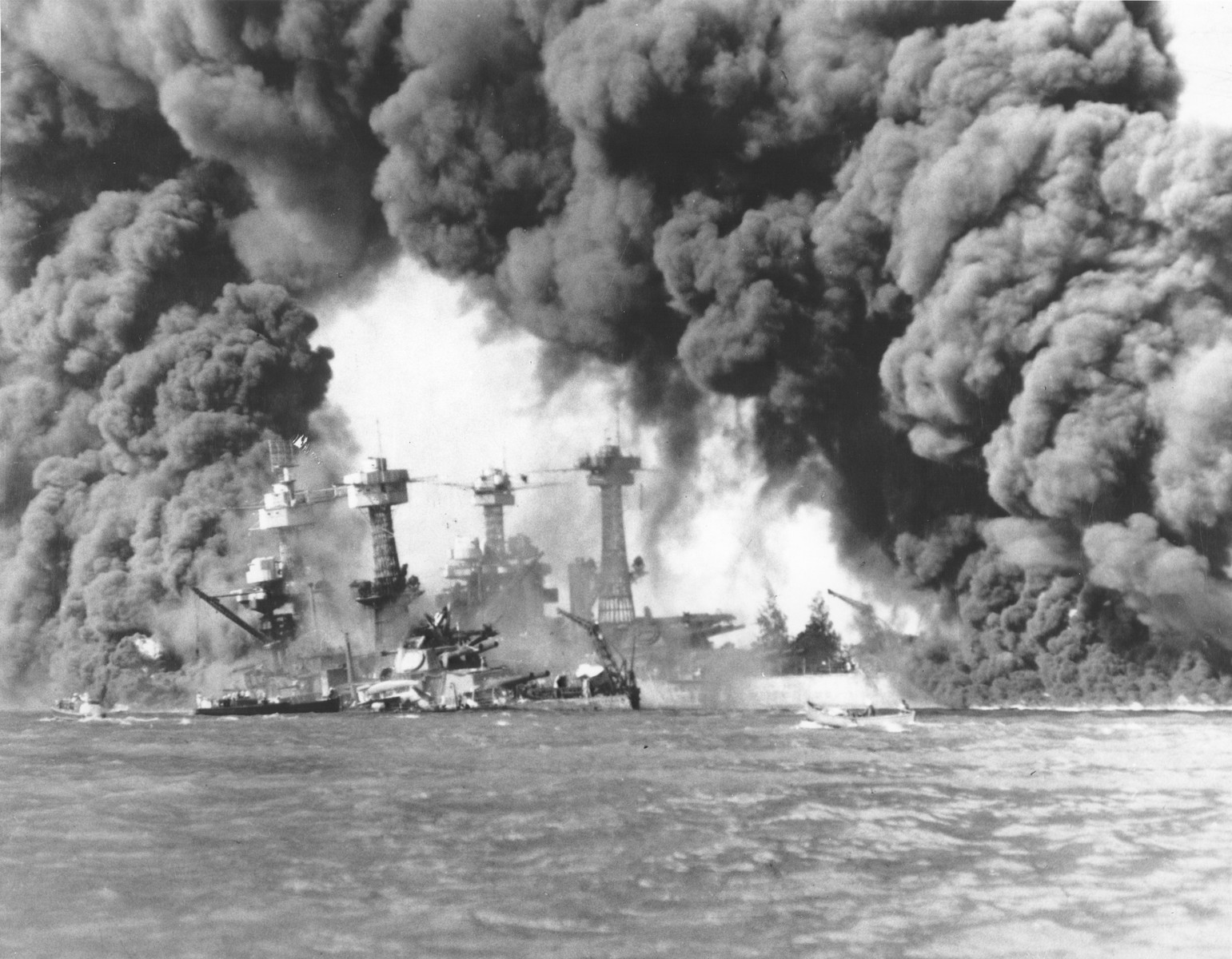 Smoke billows out from U.S. ships hit during the Japanese air attack on Pearl Harbor.