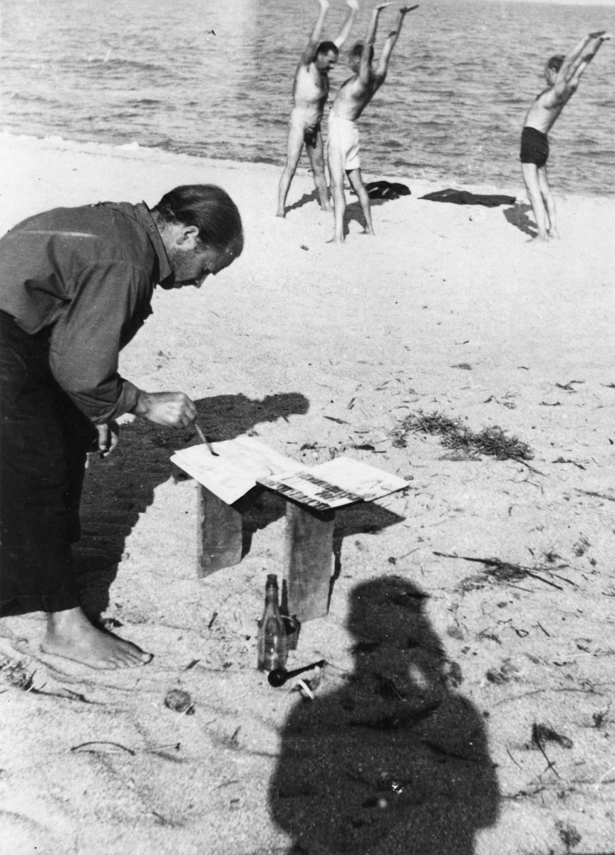 "A prisoner in the Saint Cyprien internment camp paints a picture outside on a sandy beach.  The artist has been identified as Karl Schwesig.   The original Hirshhorn Museum caption reads: ""An artist attempting to work at St. Cyprien, the concentration camp known as, ""the pesthole of the Pyrenees."""