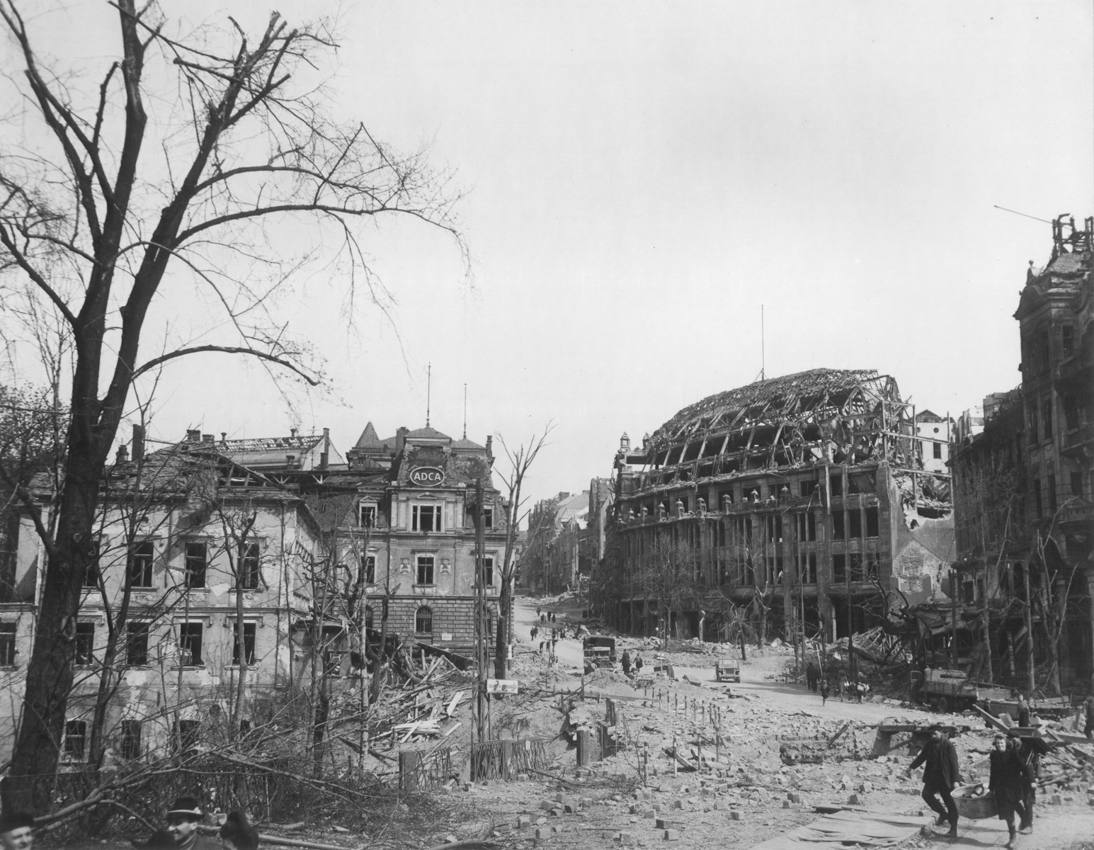View of destroyed buildings on a city street in Germany at the end of World War II.