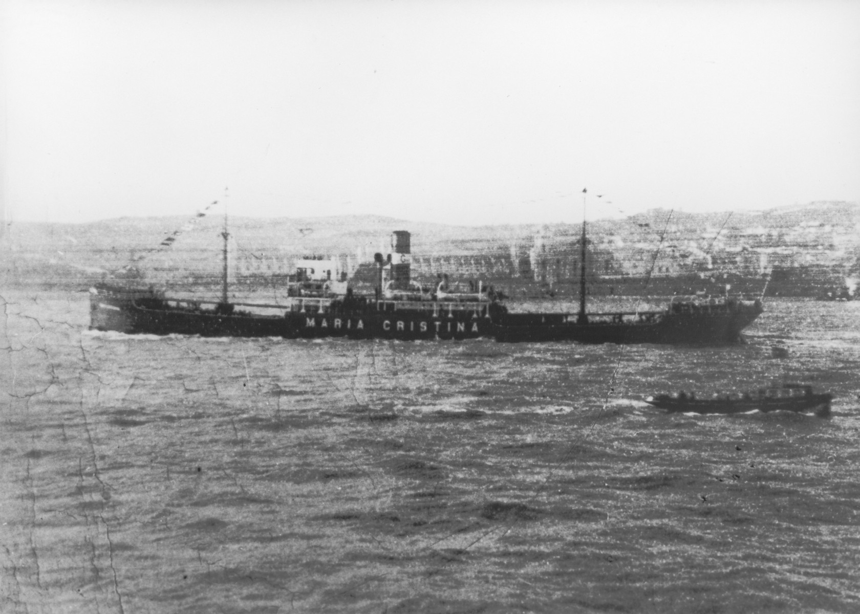 "View of the Portuguese freighter SS Maria-Christina at sea.     McCabe's caption reads, ""Portuguese freighter on which K. Frucht reached the U.S."""