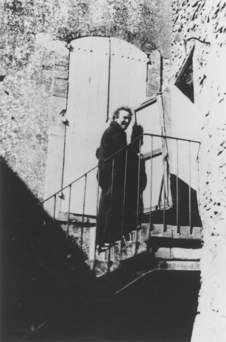 Artist Marc Chagall poses on the stairs of his residence in Gordes, France.