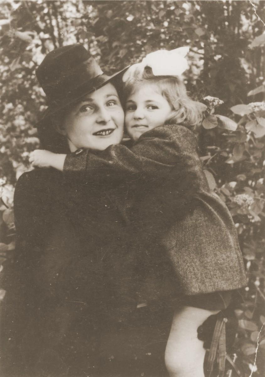 Polish rescuer Genowefa Starczewska-Korczak holds Celina Berkowitz, the Jewish child she protected during World War II.