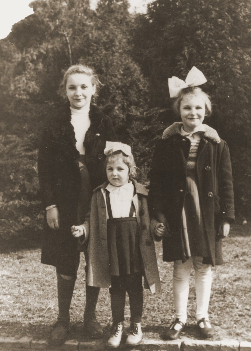 A Jewish child in hiding (center) poses with the daughters of her Polish rescuer, Genowefa Starczewska-Korczak.  Pictured are Celina Berkowitz (center) with Wanda and Teresa Starczewska-Korczak.