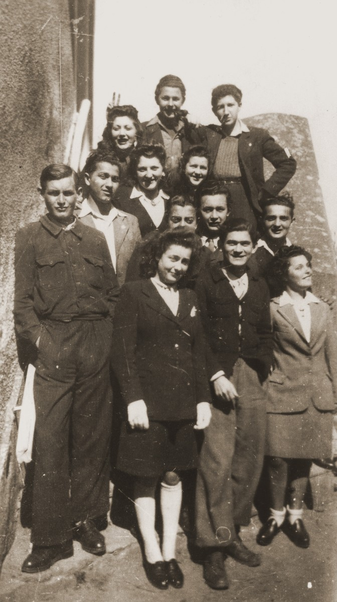 "Group portrait of members of ""La Sixieme"" [The Sixth], a Jewish underground rescue network operating in the southern zone of France.  Leo Bretholz is pictured in the second row from the front at the left, wearing a white shirt.  Formed by Robert Gamzon, leader of the Jewish scouting movement, Eclaireurs Israelites de France (EIF), ""La Sixieme"" sought to provide documentation and hiding places for Jewish children and to smuggle them over the borders into Spain and Switzerland."