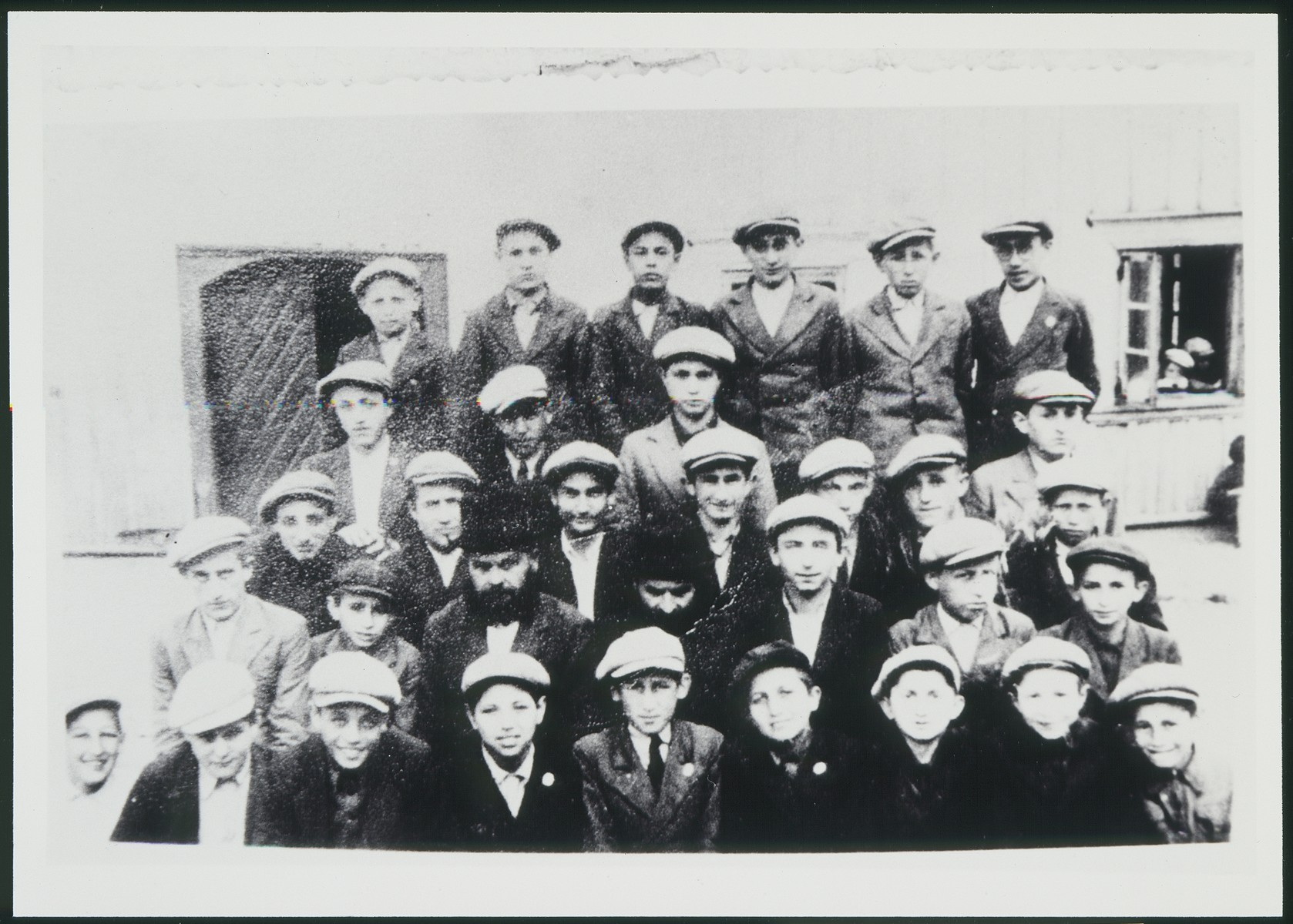 Group portrait of students in a small yeshiva in Eisiskes.    Those pictured include Avraham Aviel, Rabbi Mordechai Berr, Rabbi Mendel and Shora Lamtah.