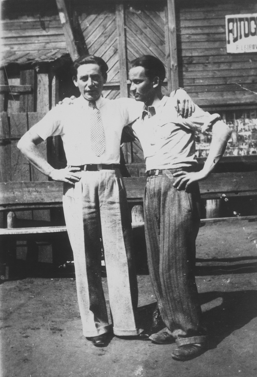 Etchke Jurdyczanski (right) stands next to his friend Shmuel Berkowicz in front of Rephael Lejbowicz's photography studio on Vilna Street.    Etchke Jurdyczanski (Isaac Juris) survived the Holocaust in Siberia and Shmuel Berkowicz immigrated to Palestine.